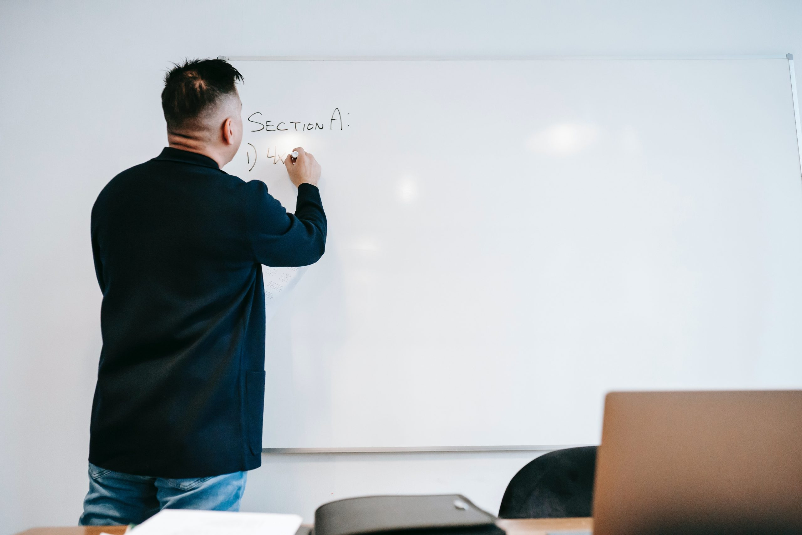 further-education-educator-lecturer-writing-on-the-board